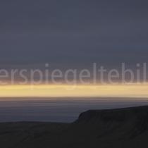 Landschaft bei Snæfellsnes mit Sonnenunter- / aufgang