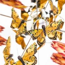 überbelichtete Spigelungen von Schmetterlingen und Blüten in einer Spiegelkonstruktion